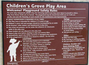 Children's playground sign: Whole lotta rules.